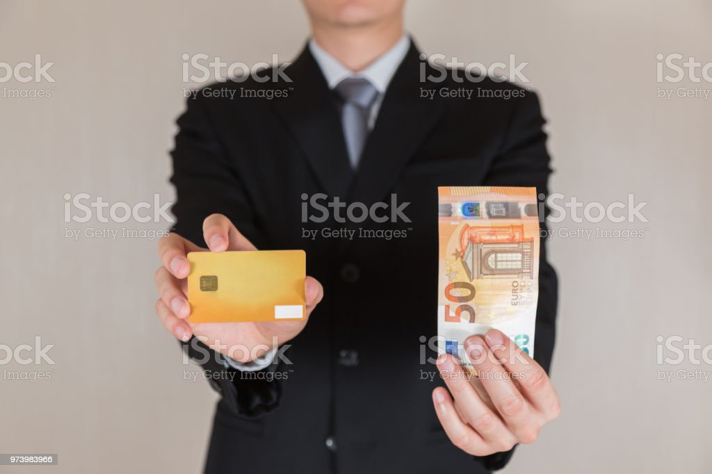 Businessman hold 50 euro money and credit card as business trade businessman hold 50 euro eur money and credit card as business trade reheart Choice Image