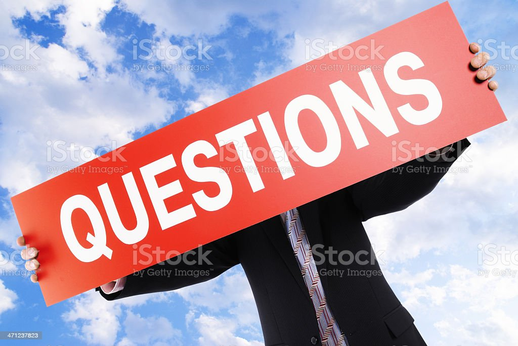businessman hold a placard with word 'Questions' royalty-free stock photo