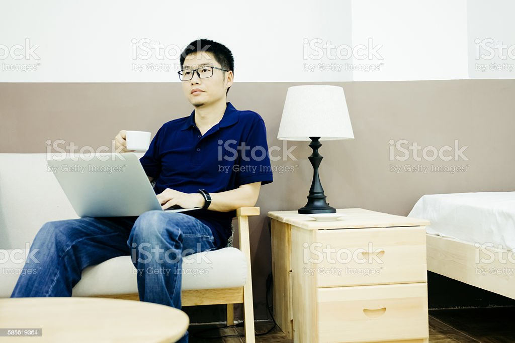 Businessman hold coffee cup indoors stock photo