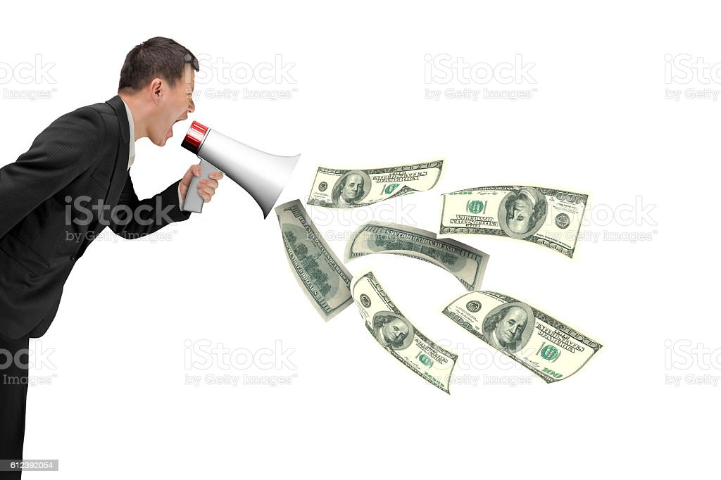 Businessman hold megaphone with dollar bills spraying out stock photo