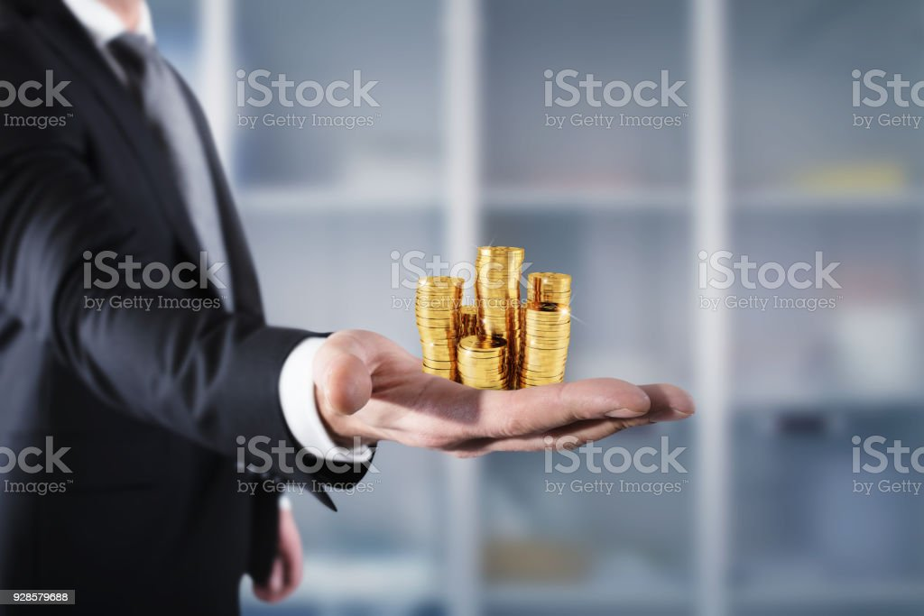 Businessman hold piles of money. Concept of success and company growth - Foto stock royalty-free di Adulto