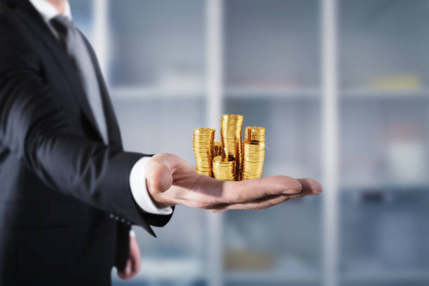 Businessman hold piles of money. Concept of success and company growth - foto stock