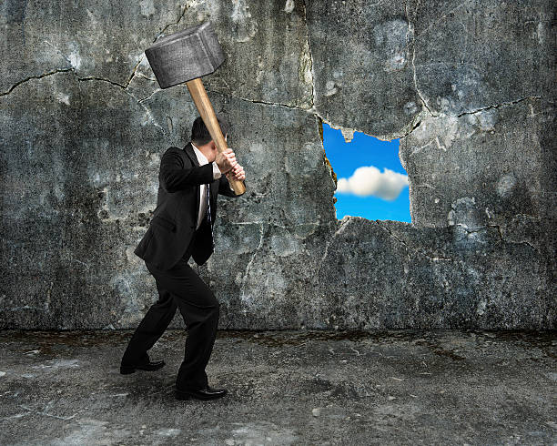 businessman hold sledgehammer cracking big hole discovered natur stock photo