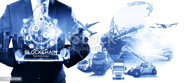 istock Businessman hold the blockchain hologram on tablet, Business and Technology, Internet of thinks and network the concept of cryptocurrency, blockchain, logistics technology transportation concept