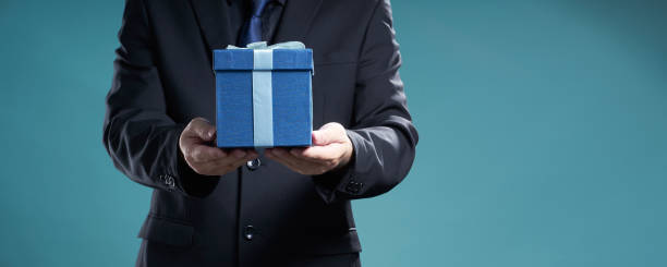 Businessman hold the present box stock photo
