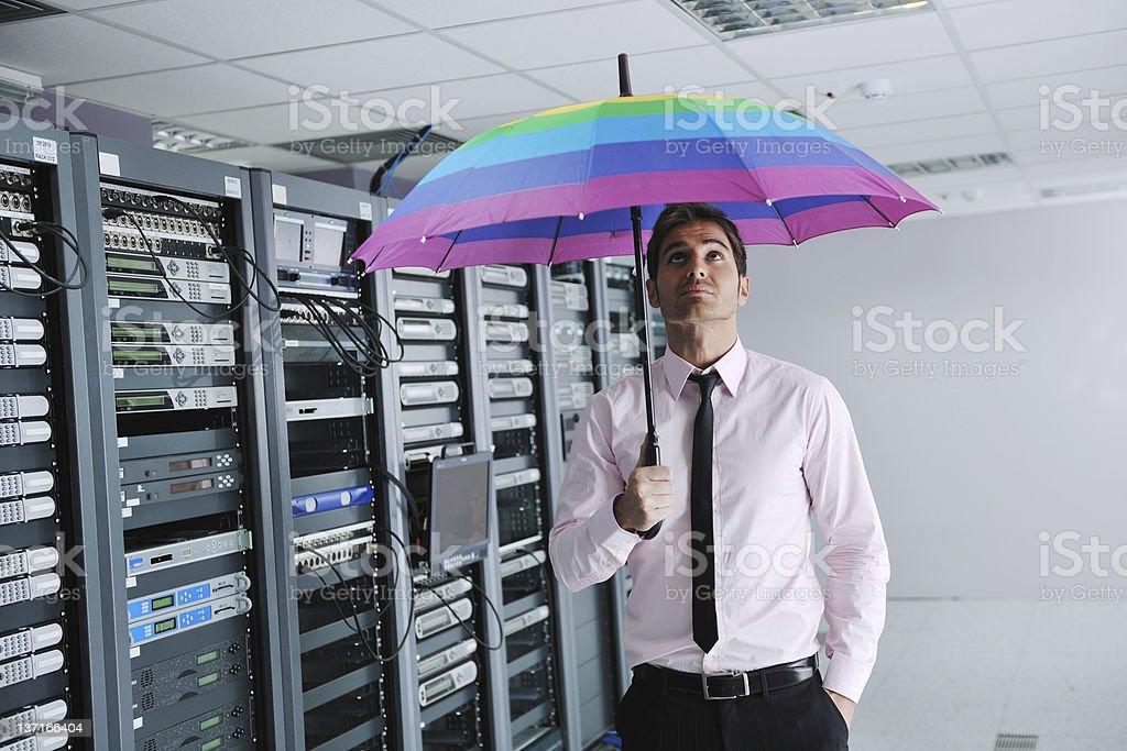 businessman hold umbrella in server room stock photo