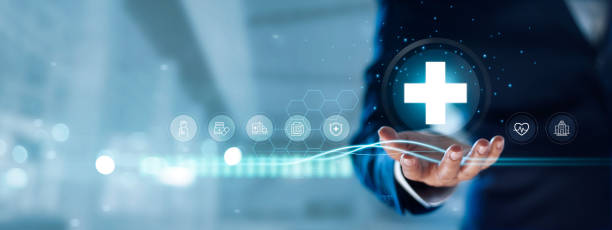 Businessman hold virtual medical network connection icons. Covid-19 pandemic develop people awareness and spread attention on their healthcare, rising growth in hospital and health insurance business. stock photo