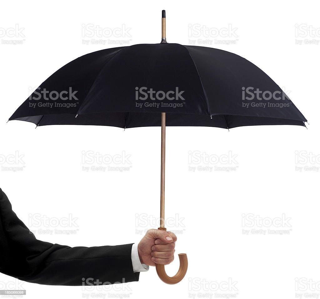 Businessman Holding a Black Umbrella stock photo