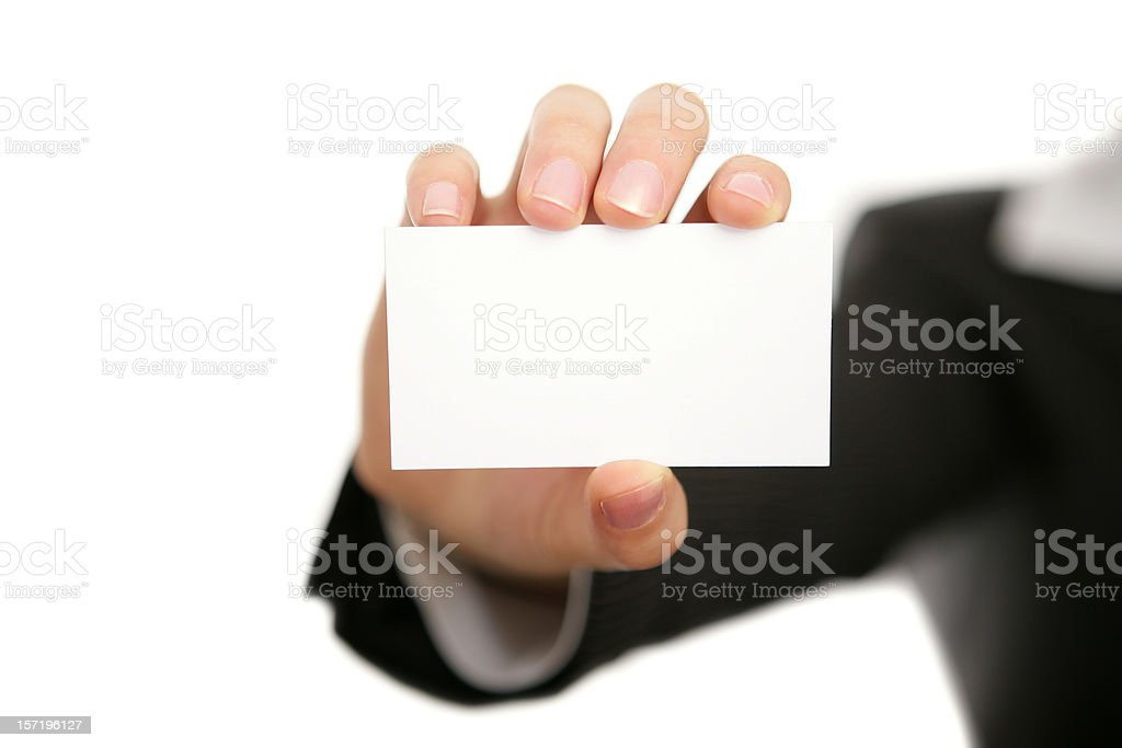 A businessman holding a blank business card royalty-free stock photo
