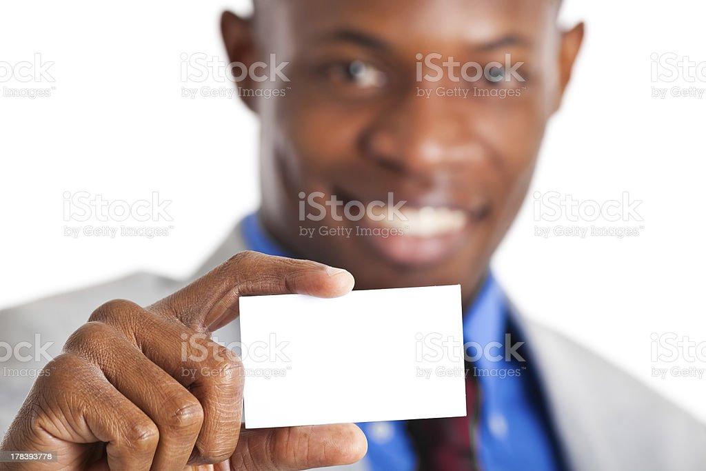 Businessman holding a blank card stock photo