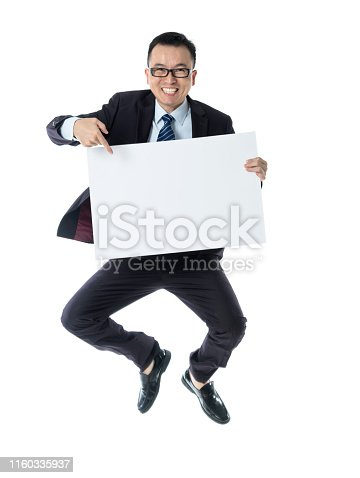 Businessman holding a blank placard on white background.