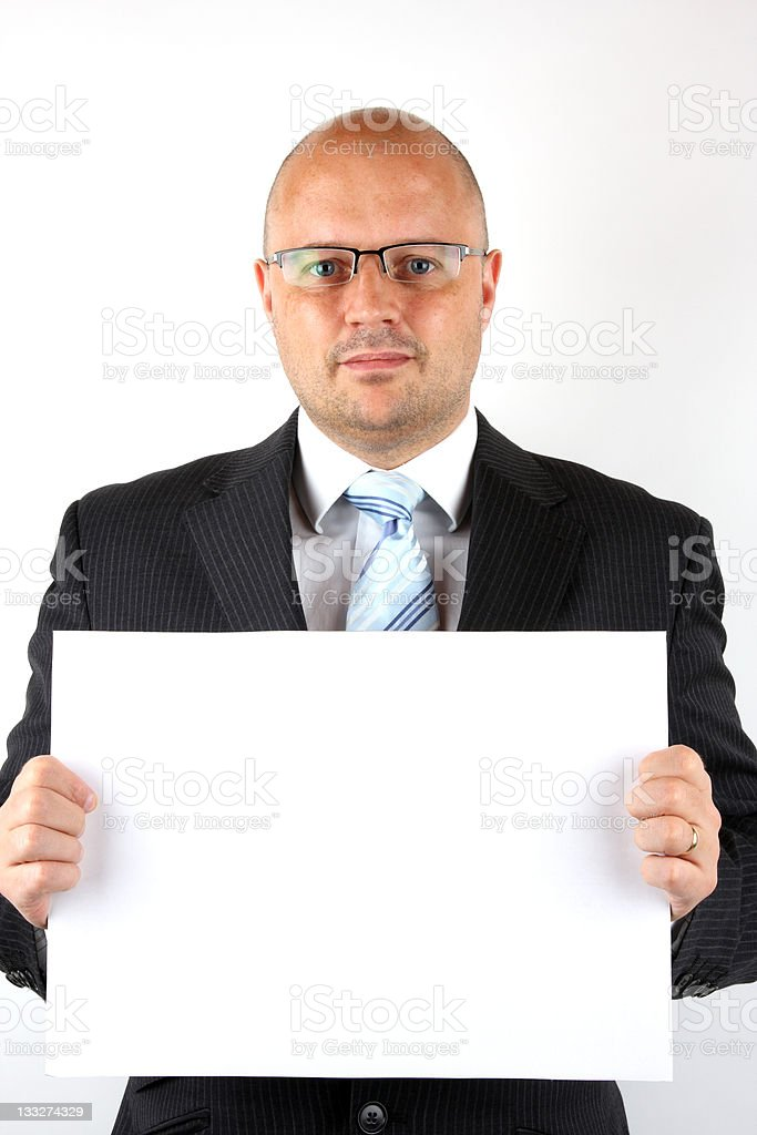 Businessman holding a blank sign for your message royalty-free stock photo