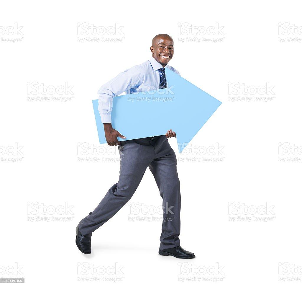 Businessman Holding a Blue Arrow Sign stock photo