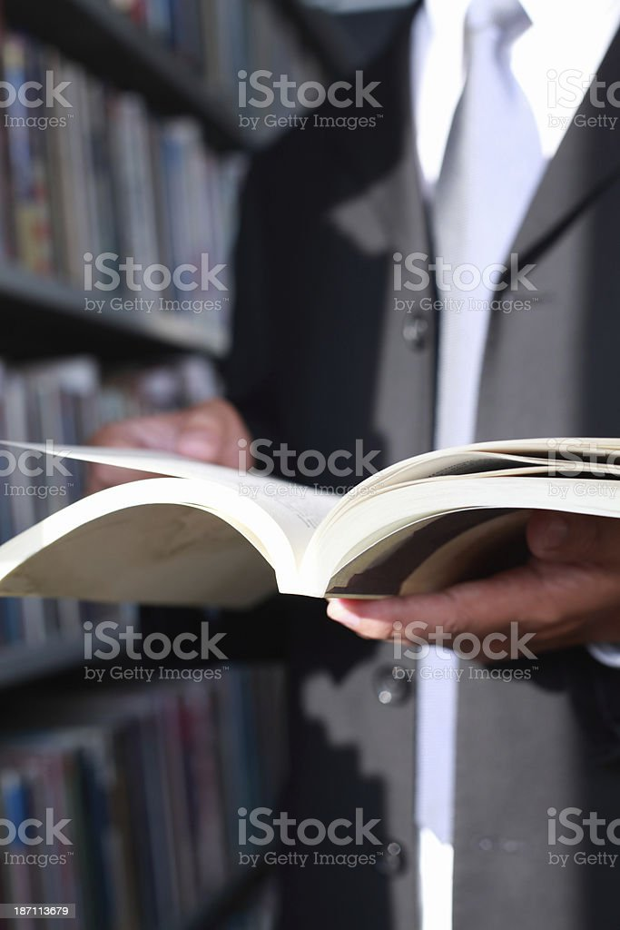 Businessman Holding a Book royalty-free stock photo