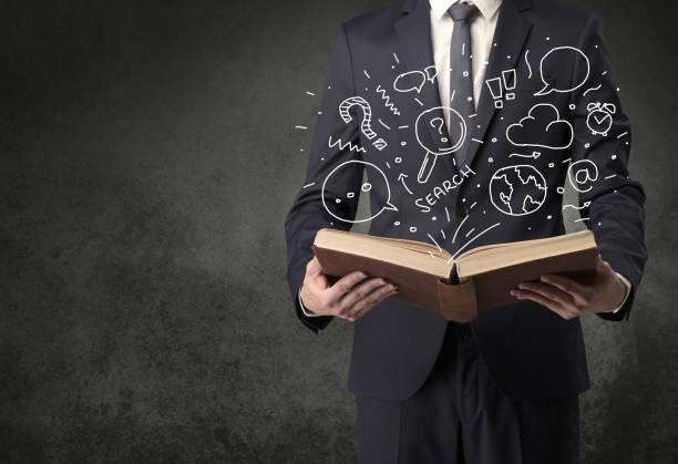 Businessman holding a book. – zdjęcie