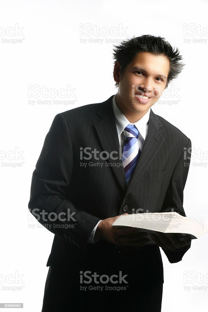 Businessman holding a book stock photo