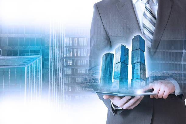 businessman holding a building, skyscraper – Foto
