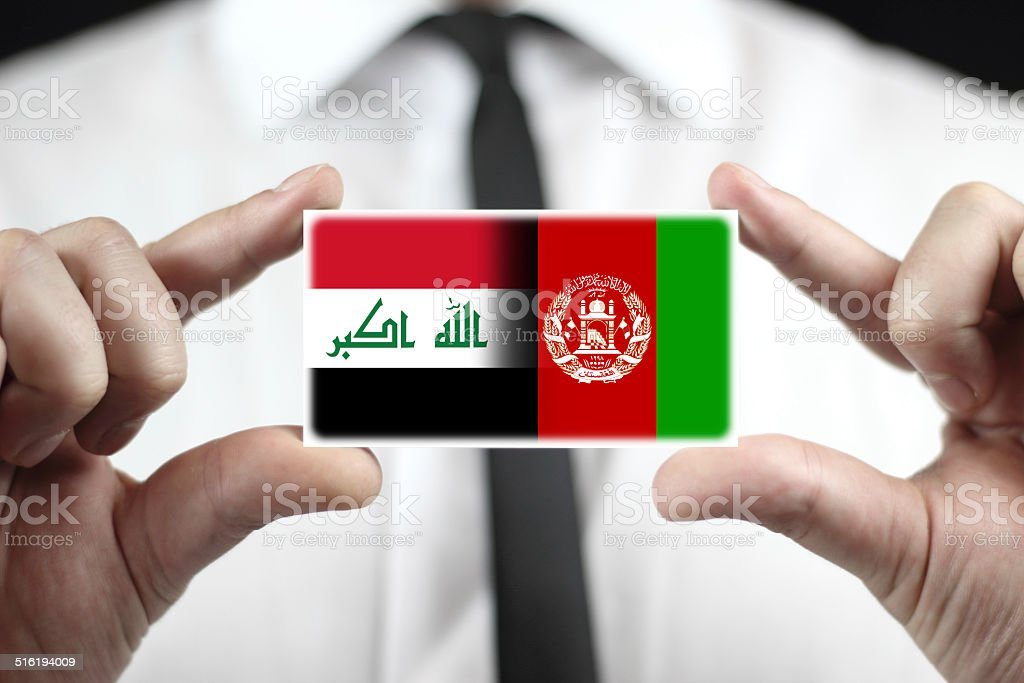 Businessman Holding A Business Card With Iraq And Afghanistan Flag ...