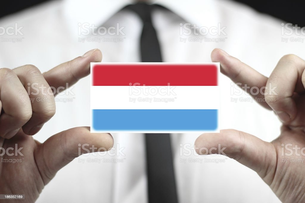 Businessman holding a business card with Luxembourg Flag stock photo