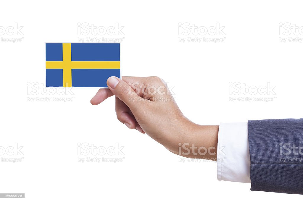 Businessman holding a business card with Sweden Flag with using path royalty-free stock photo