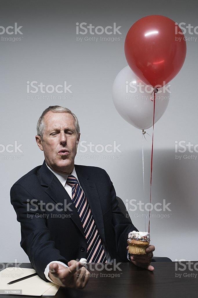 A businessman holding a cake 免版稅 stock photo
