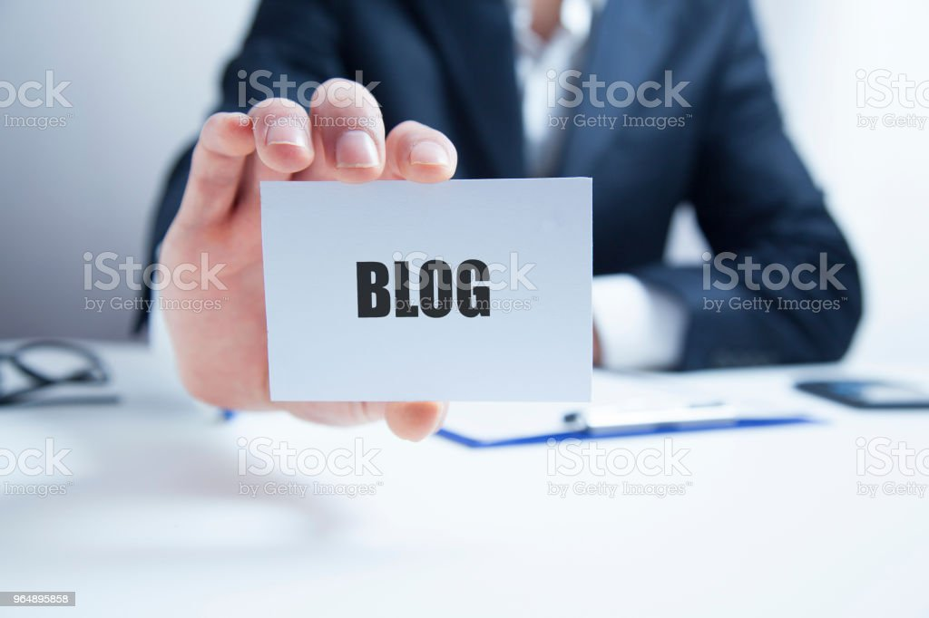 businessman holding a card with text BLOG royalty-free stock photo
