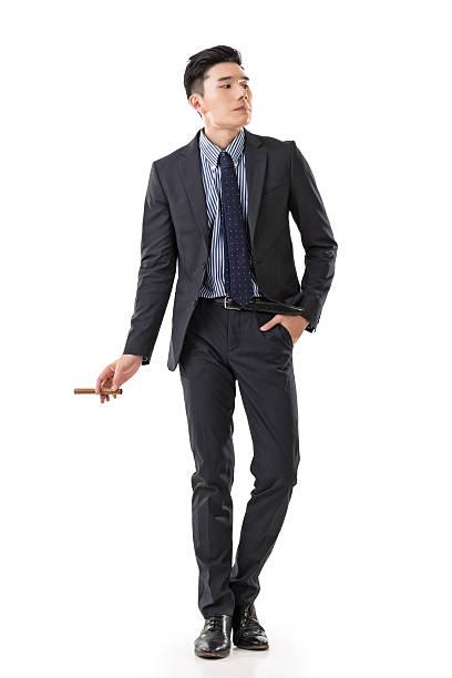 businessman holding a cigar stock photo