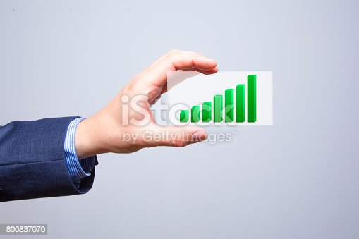 860389678istockphoto Businessman holding a concept of the increase and growth of statistics in business. 800837070