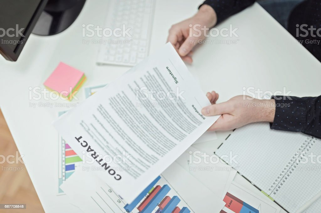 Businessman holding a contract stock photo