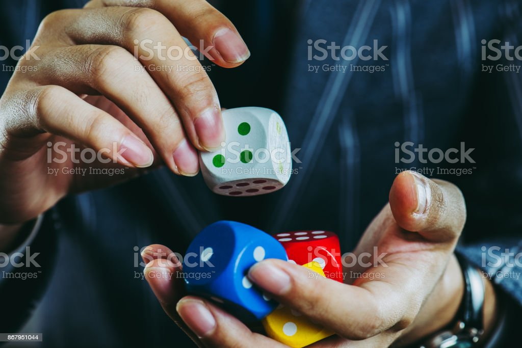 Businessman Holding A Dice Stock Photo - Download Image Now