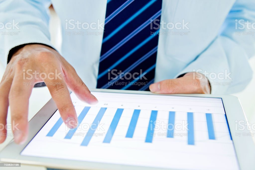 A businessman holding a digital tablet working stock photo