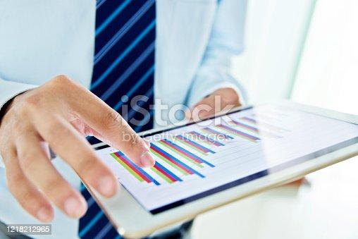 A businessman holding a digital working