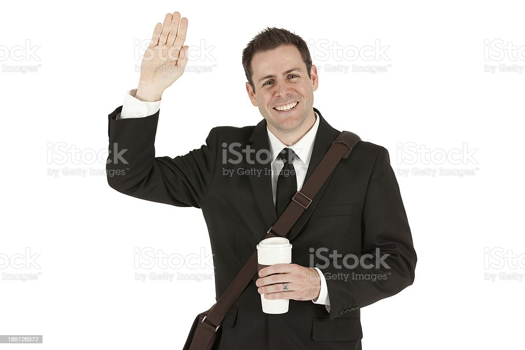 Businessman holding a disposable cup and waving hand royalty-free stock photo