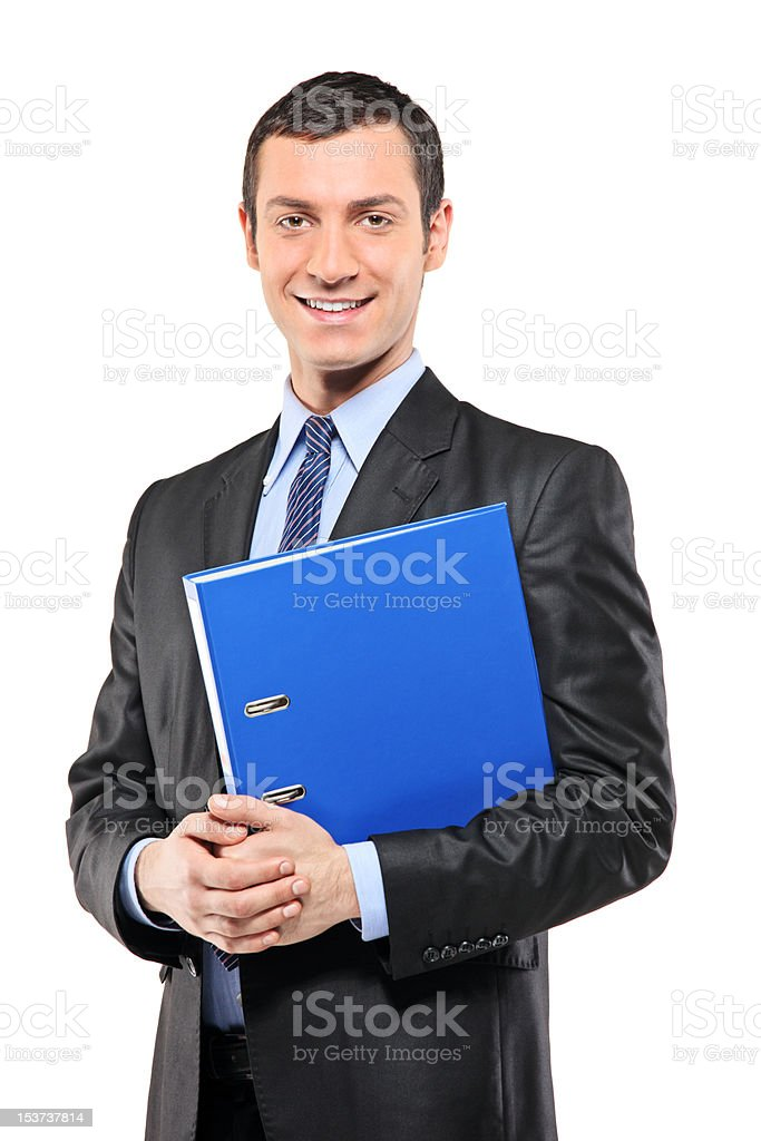 Businessman holding a fascicule royalty-free stock photo