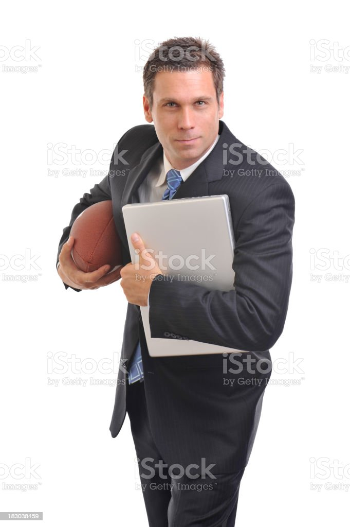 Businessman holding a football and Laptop Computer on White royalty-free stock photo