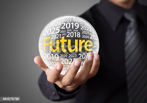 Businessman holding a glass ball,foretelling the future.