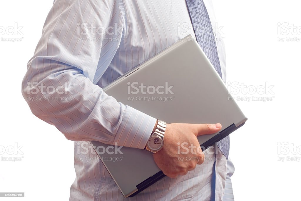 Businessman holding a laptop computer royalty-free stock photo
