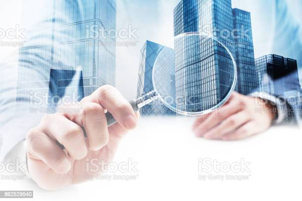 Businessman holding a magnifying glass with double exposure cityscape picture id862529540?b=1&k=6&m=862529540&s=612x612&h=vdwmsa zghntoepfc4xhb 5kztdxl6hnha8jzekfguy=