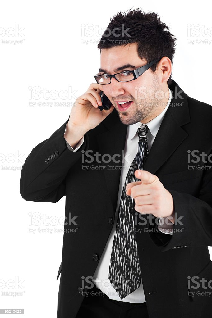 Businessman holding a mobile phone and pointing with finger royalty-free stock photo