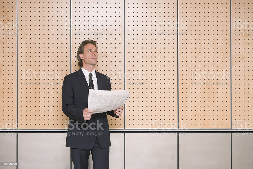 A businessman holding a newspaper 免版稅 stock photo