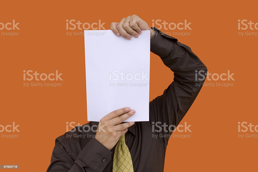 Businessman holding a paper face royalty-free stock photo