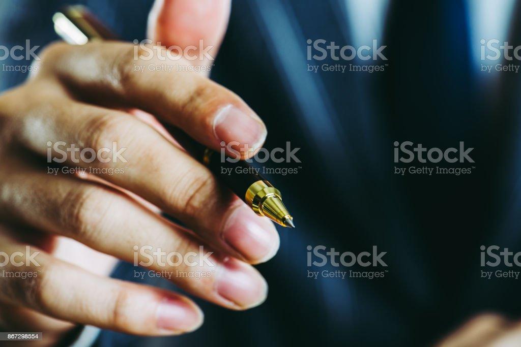 Businessman holding a pen stock photo