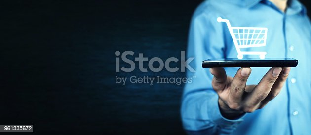 Businessman holding a phone with a shopping icon. Online shopping
