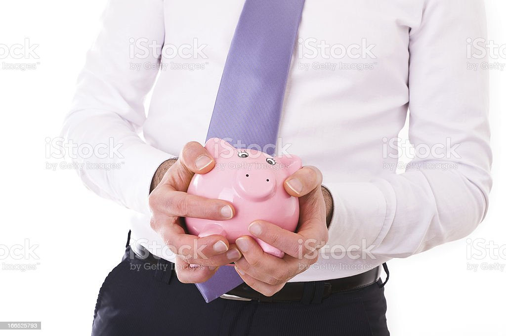 Businessman holding a piggy bank. royalty-free stock photo