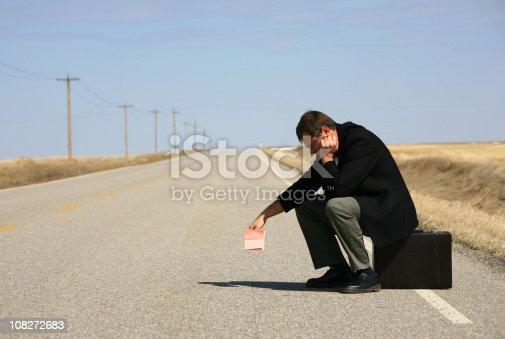 istock Businessman Holding A Pink Slip 108272683