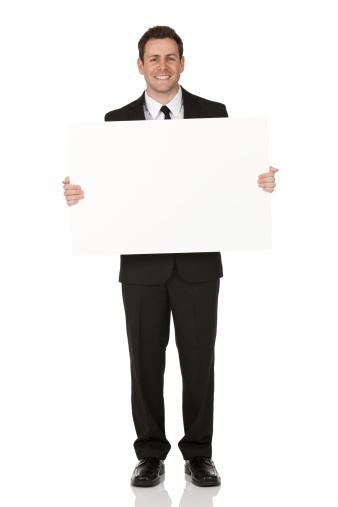 istock Businessman holding a placard 171261677