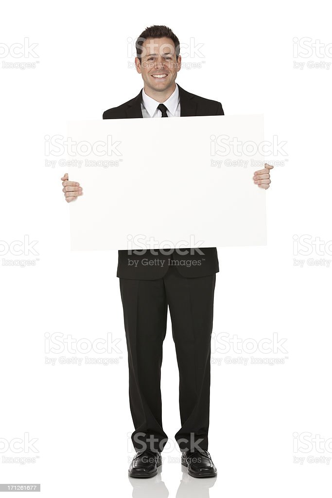 Businessman holding a placard stock photo