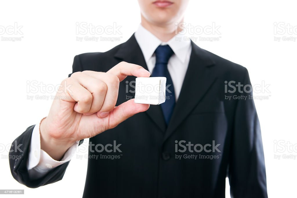 Businessman holding a small cube stock photo