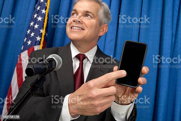 Businessman Holding A Smart Phone Stock Photo - Download Image Now