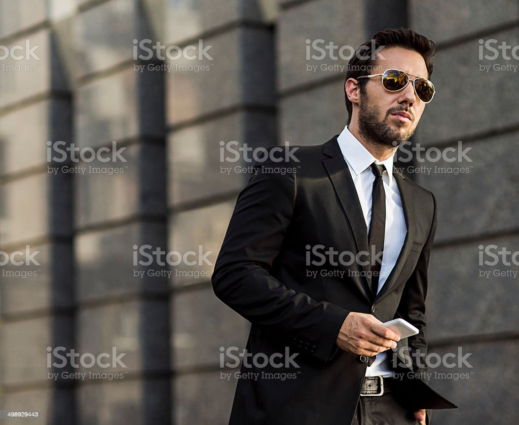 businessman holding a smart phone stock photo